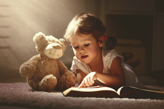aa019c5be4689fa2af930fa2f659cbfc5edb4a39_child-reading-with-teddy-bear