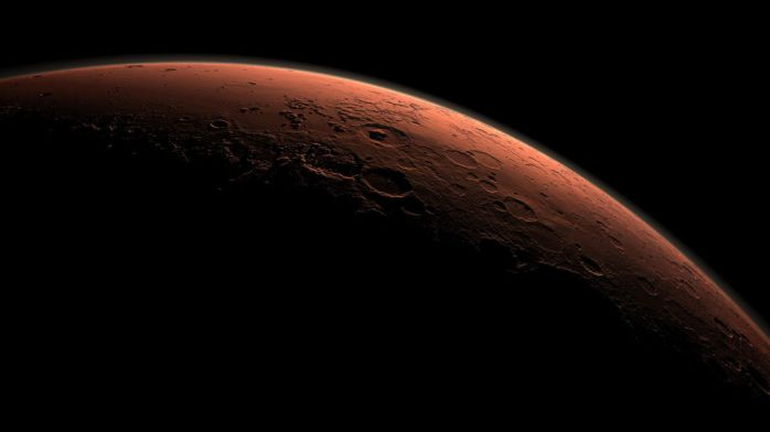 This computer-generated view depicts part of Mars at the boundary between darkness and daylight, with an area including Gale Crater beginning to catch morning light